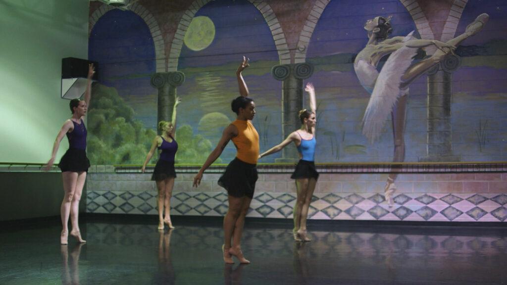 "4 ballet dancers practice in a ""ballet"" themed room"
