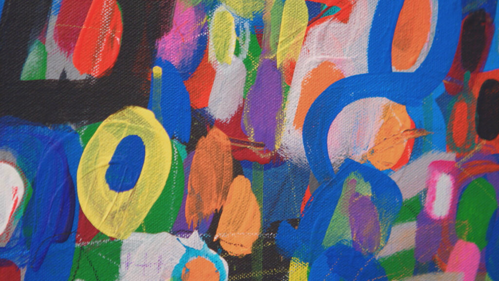 An abstract painting of lots of circle shapes in a variety of colors