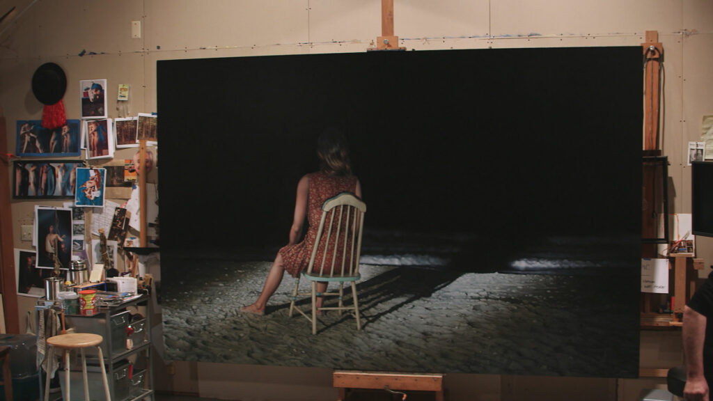 A painting of a person sitting in a chair in front of darkness