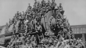 A train with a huge group of people sitting on it