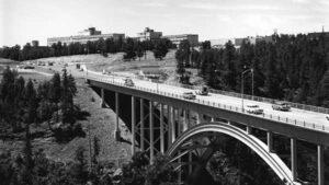 Sixty's vintage vehicles cross Los Alamos Canyon via the LA Bridge, also known as the Omega bridge