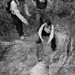Harris, Yai and PCL team leader Vilaisack discuss how to detonate a 750-pound bomb found by a local woman clearing land for a garden near Sophoon.