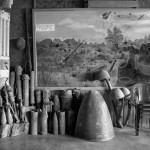 The lobby of the Vinh Thong Guesthouse in Phonsavan displays an amazing array of defused UXO as well as a mural depicting fighting around the Plain of Jars in 1968.