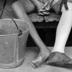 Pae lost his leg to a landmine in 1963. His bucket is made from the aluminum tubes of American flares.