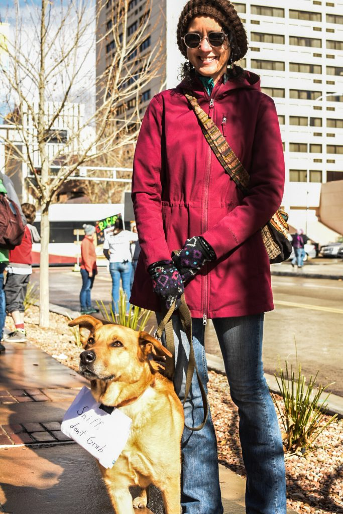 "Luci Alfonso and Bumper stand east of the Civic Plaza main stage, during the ABQ Women's Rally, Saturday, Jan. 21st, 2017, in Albuquerque, NM. The rally in Albuquerque was a single gathering held in concert with hundreds of rallies and marches spread across the country and around the world. The sister rally in Civic Plaza was ""to show solidarity across the nation and at home,"" according to social media accounts affiliated with the rally. (Kevin Maestas)"