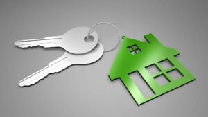 CG illustration of keys with a green house ornament as keychain.