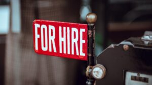 """A small sign reads """"FOR HIRE""""."""
