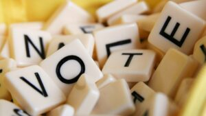 "Close-up of Scrabble tiles that read ""VOTE""."