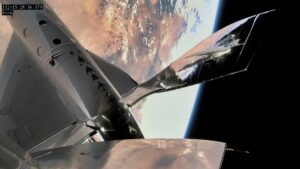 Exterior view of a Virgin Galactic spaceship orbiting Earth.
