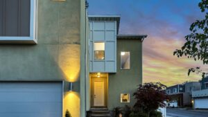 A house in a residential neighborhood at dusk.