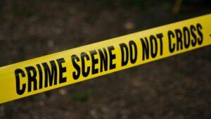 """Close-up of """"CRIME SCENE DO NOT CROSS"""" tape."""