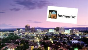 Downtown Albuquerque skyline at evening, with superimposed logo for Homewise.