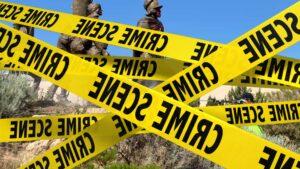 """CRIME SCENE"" tape covers mounments."