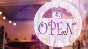 "A wooden ""Open"" sign."