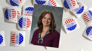 """An image of Rebecca Dow on top of a background of """"I Voted"""" stickers."""