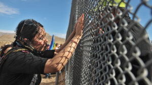 People from Mexico and U.S. sides joined together for a binational peace demonstration at the Sunland Park-Anapra border fence.