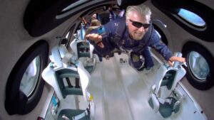 A person experiencing zero gravity and floating in a spaceship cabin.