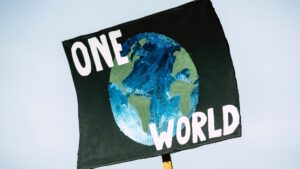 """A poster with the Earth and """"ONE WORLD"""" painted on it."""