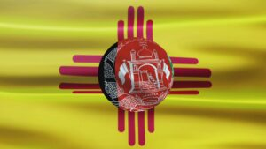 Composite of the New Mexican flag, with part of the Afghanistan flag in the Zia symbol.