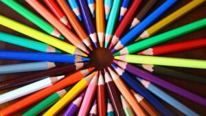An array of colored pencils organized in a circle.