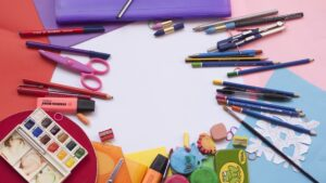 A table with school supplies littered everywhere