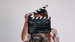 A person holding a film slate/clapper