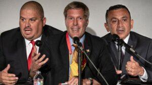 Eddy Aragon, Tim Keller, and Manny Gonzales speak at a forum.