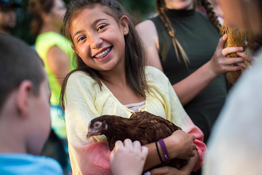 Science Girl holding Chicken