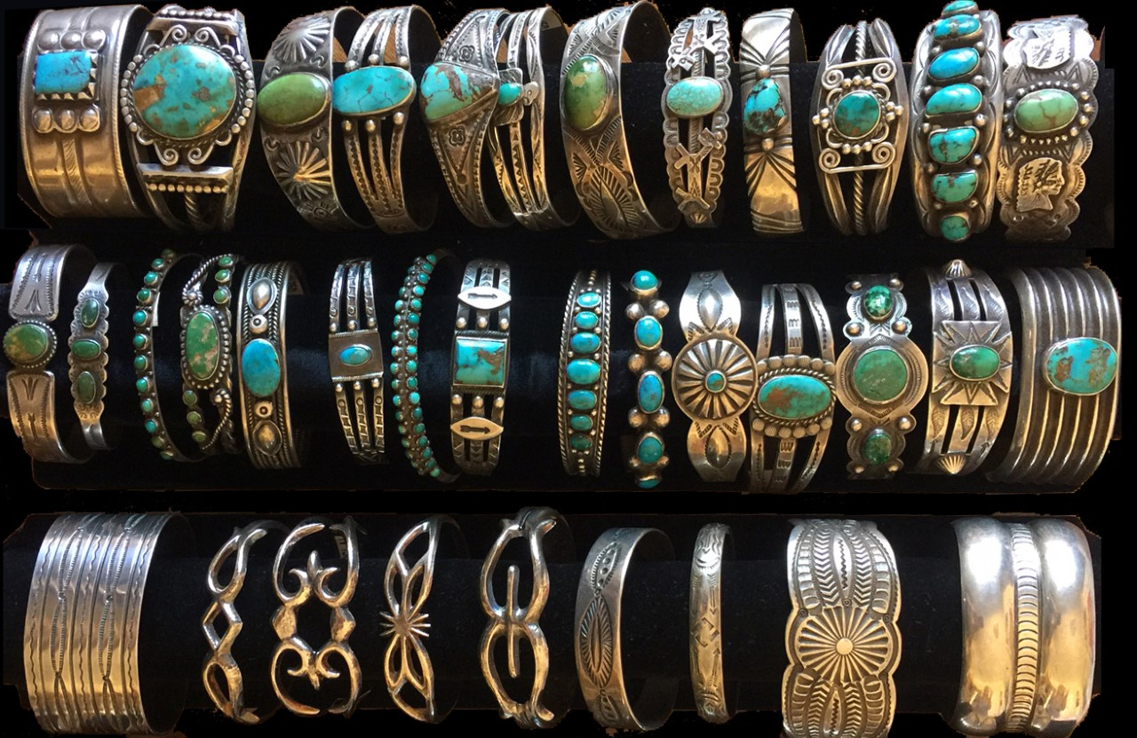 Turquoise bracelets featured in three rows.